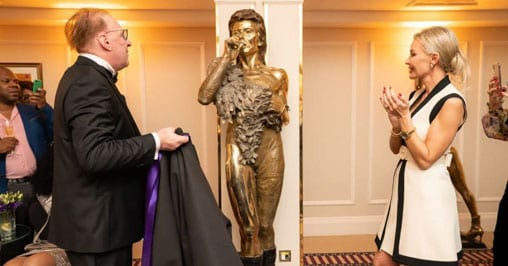 article-Christian-Maas-and-Natalia-Cola-at-The-Westbury-Mayfair-with-David-Bowie-Sculpture